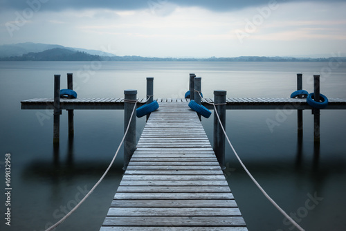 Fototapety, obrazy: Evening time. Wooden pier on the lake.