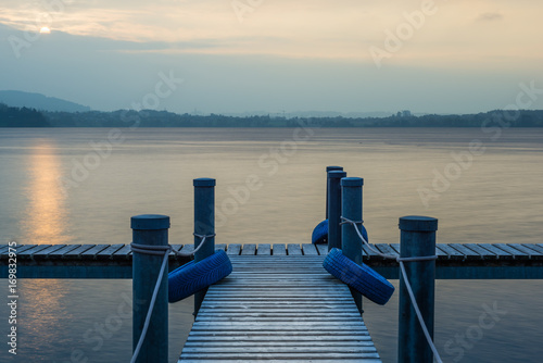Fototapety, obrazy: Berth. Pier. Sunset on the lake.