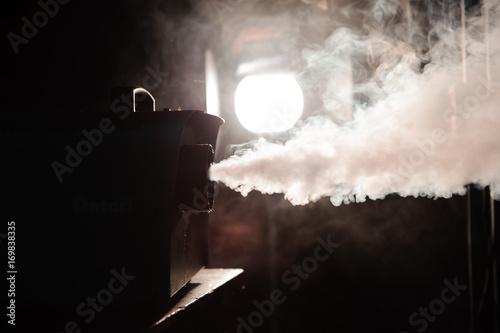 Fototapety, obrazy: lights in smoke, studio lights shining through the smoke from smoke machine.