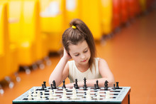 Girl Are Playing At A Chess Ta...