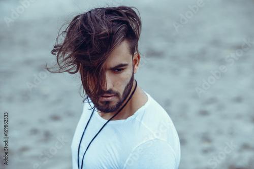Obraz na plátně  Portrait of a man with beard and modern hairstyle