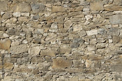 Photo sur Toile Cailloux mur en pierre