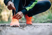 Young Black Woman Runner Tying...