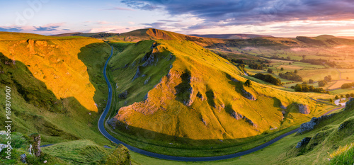 Deurstickers Luchtfoto Aerial view of long winding road leading through mountains in the Peak District.