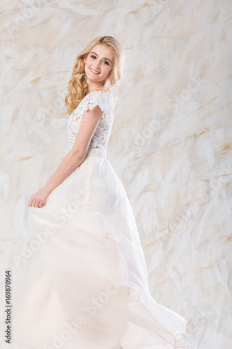 Fashionable Wedding Dress Beautiful Blonde Model Bride Hairstyle
