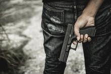 A Man Holding A Gun In Hand, T...