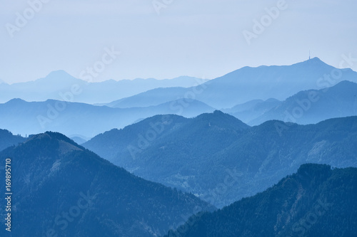 Mountain tops covered in morning haze seen from the top of the Panoramastrasse on Mt Canvas Print
