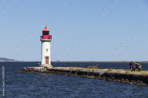 Foto op Aluminium Vuurtoren The Les Onglous lighthouse, terminating point of the Canal du Midi where the it enters the Etang de Thau. World Heritage Site. Agde, France