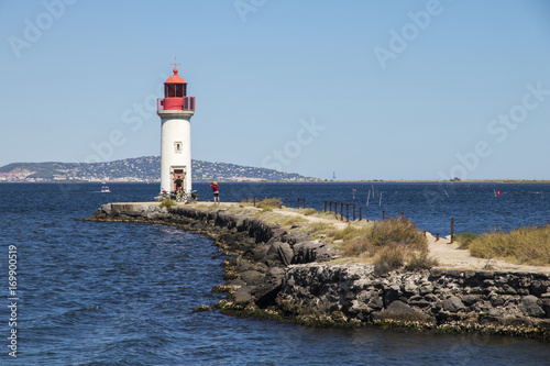 Foto op Canvas Vuurtoren The Les Onglous lighthouse, terminating point of the Canal du Midi where the it enters the Etang de Thau. World Heritage Site. Agde, France