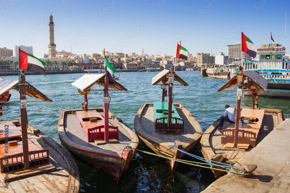 Fototapeta Traditional Abra ferries at the creek in Dubai, United Arab Emirates