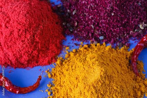 Fototapeta Colorful heap of spices. Aromatic landscape with seasoning. Paprika, turmeric, imbir, nutmeg obraz