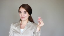 Business Woman Holding Rotating Spinner In Her Hand.