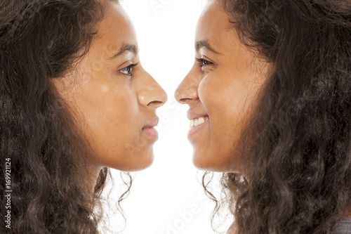 Valokuva  comparison of young women before and after nose surgery