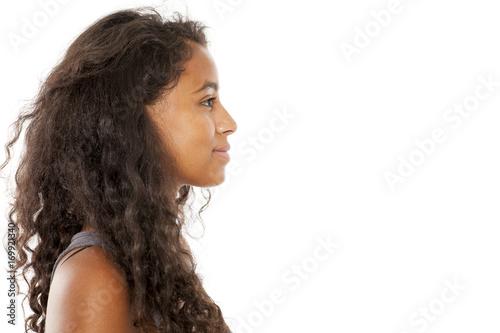 Valokuvatapetti profile of a smiling, beautiful young dark-skinned woman