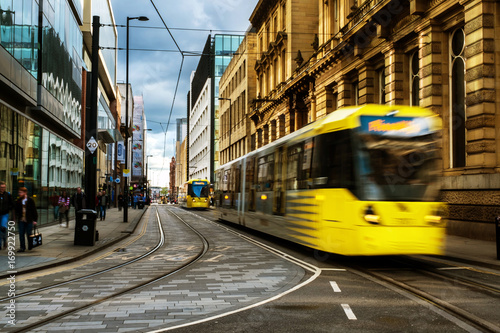 Light rail yellow tram in the city center of Manchester, UK Canvas Print
