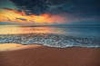 Beautiful sunrise over the sea water and waves