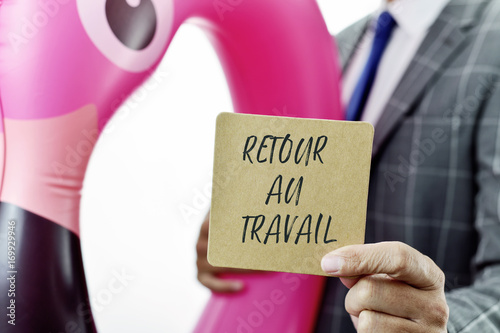 Fotomural  businessman and text back to work in French