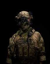 Soldier In Military Uniform With Night Vision Goggles On Background Of Dark Wall 16