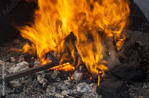 Valokuvatapetti Old-fashioned blacksmith furnace with burning coals