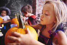 Kids Preparing A Pumpkins For Halloween