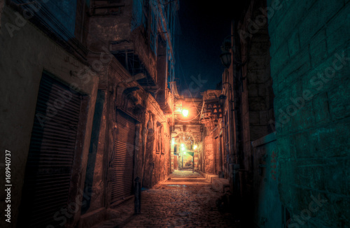 Photo Stands Narrow alley Light at the end of the alley