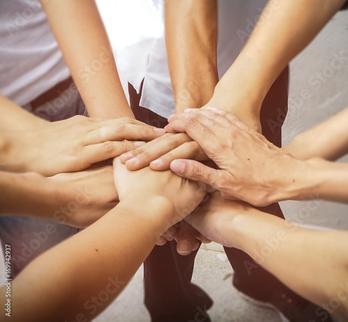 Fototapety, obrazy: Close up the human hands unity,abstract art design.blury light background,hands together in form of team work.warm light tone.