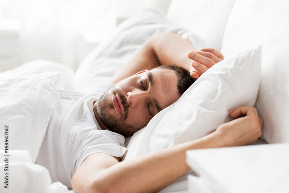 Fototapety, obrazy: man sleeping in bed at home