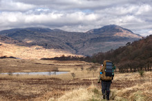 A Hiker Making Their Way Along The Iconic West Highland Way Scotlands Oldest Long Distance Trail