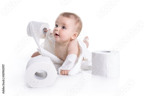 Fotografie, Tablou Toddler ripping up toilet paper in bathroom studio