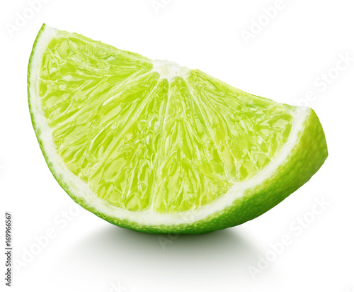 Ripe slice of green lime citrus fruit isolated on white background