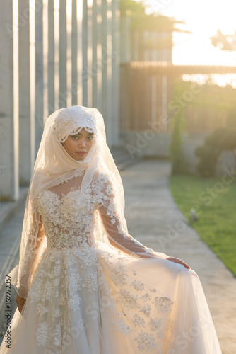 Portrait Of A Beautiful Muslim Bride With Make Up In White Wedding Dress With Beautiful White Headdress Natural Light Buy This Stock Photo And Explore Similar Images At Adobe Stock,Short White Plus Size Wedding Dresses