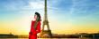 happy tourist woman against Eiffel tower in Paris, France