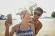 Young couple taking a selfie on a beach