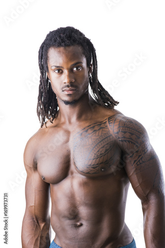 684a0b4bb9 African American bodybuilder man, naked muscular torso, wearing pants only,  against white background in studio shot
