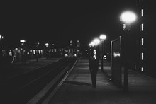 Woman Walking In Train Station...