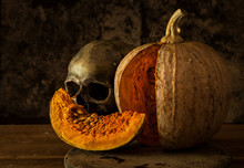 Still Life With Skull, Candle And Pumpkin