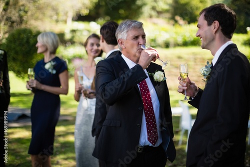 Poster Equitation Guests having champagne while attending wedding