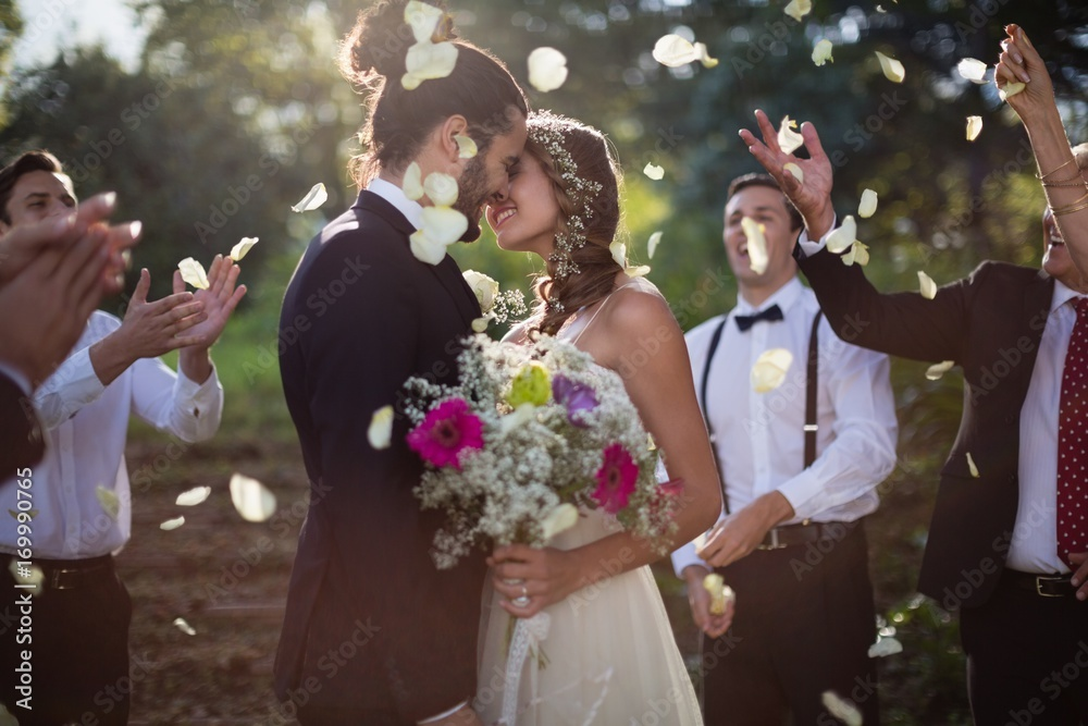 Fototapety, obrazy: Affectionate bride and groom kissing on their wedding day