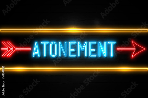 Photo Atonement  - fluorescent Neon Sign on brickwall Front view
