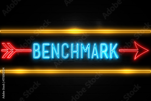 Benchmark  - fluorescent Neon Sign on brickwall Front view Canvas Print