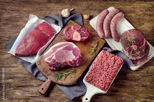 Staande foto Vlees Different types of raw meat on dark wooden background.