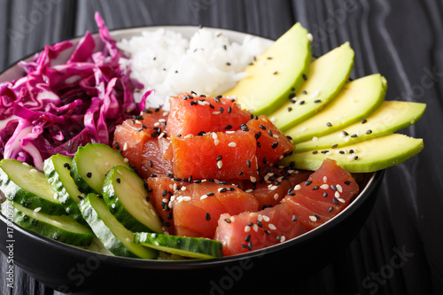 Raw Organic Ahi Tuna Poke Bowl with Rice and Veggies close-up. Horizontal