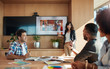 canvas print picture - Female coworker making presentation in office