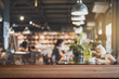 canvas print picture - Empty wooden table space platform and blurry defocused restaurant interior, Vintage tone