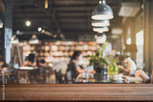 Tuinposter Restaurant Empty wooden table space platform and blurry defocused restaurant interior, Vintage tone