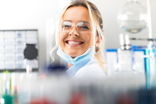 Happy Young Attractive Smiling Woman Scientist In The Laboratory