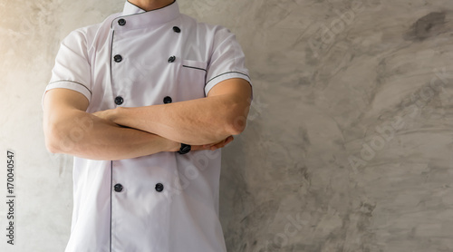 Handsome caucasian man professional Chef arms crossed in white uniform on gray c Fototapeta