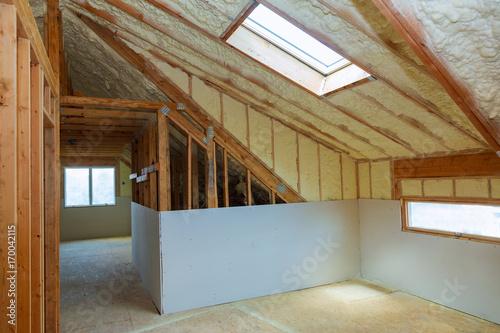 Obraz na plátně termal insulation installing at the attic