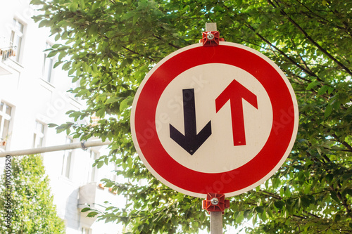 Valokuva  traffic sign with black and red arrows