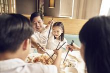 Family Eating Yu Sheng